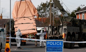 Military personnel remove a vehicle connected to the poisoning of Sergei Skripal from a residential street in Gillingham, Dorset.