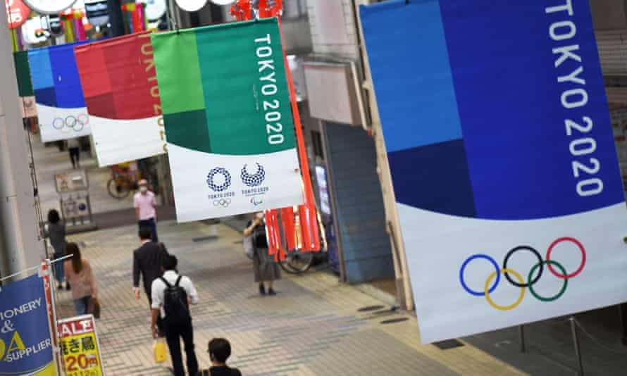 a banner of the Tokyo Olympics 2020 is on display near Nakanobu Station in Tokyo