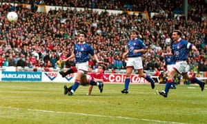 Mark Hughes scores in an FA Cup semi-final against Oldham in 1994.