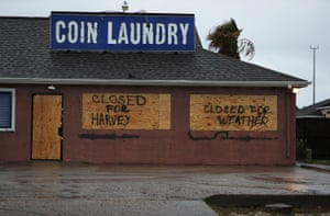 """A sign on a laundry business reads: """"Closed for Harvey"""", as residents prepare for the approaching hurricane in Corpus Christi, Texas"""