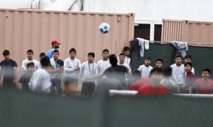 Immigrant boys play soccer at the Homestead child detention facility in Florida.