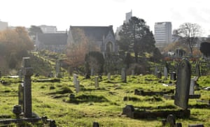 Ford Park Cemetery, with Plymouth city centre tower blocks rising behind.
