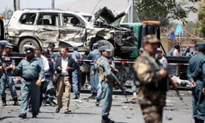 Afghan police guard the site of a suicide car bombing in Kabul on Monday. Five people were killed and 16 others were injured.