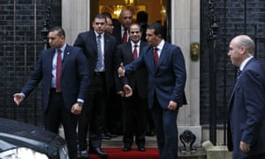 President Sisi leaves Downing Street after his talks with David Cameron.