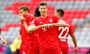 Robert Lewandowski celebrates after scoring his team's third goal.