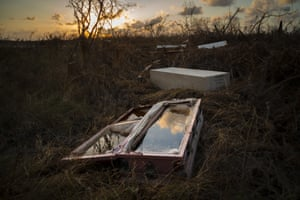 A shattered coffin filled with water in McLean's Town, the Bahamas