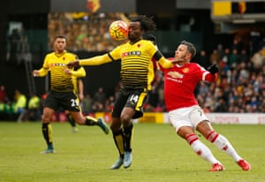 Watford's Juan Paredes holds off Memphis Depay.