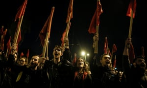 Protesters shout slogans during a march in Athens.
