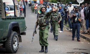 Kenyan police officer shouts orders