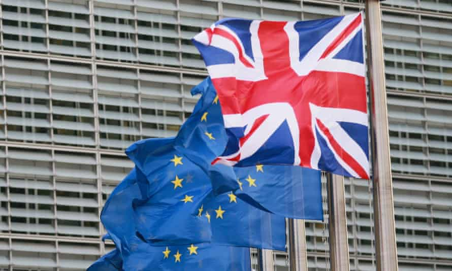 British union flag flies next to EU flags in front of European commission headquarters in Brussels