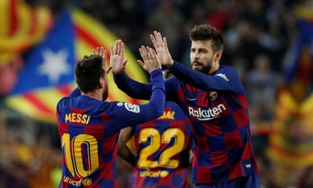 Gerard Piqué celebrates with Lionel Messi after the forward scored for Barcelona against Real Valladolidlast October.