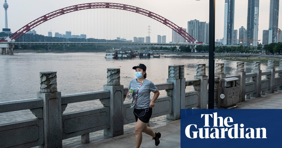 China authorities to test all Wuhan's 11 million residents amid new Covid cases