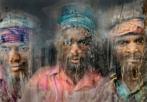 Three gravel workmen are looking through the window at work place Chittagong, Bangladesh