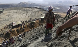 Miners search for jade stones at a Hpakant jade mine in Kachin state, Myanmar