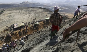 Miners search for jade stones at a mine dump at a Hpakant mine