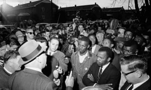 John Lewis, front with arms folded, in Selma in 1965.