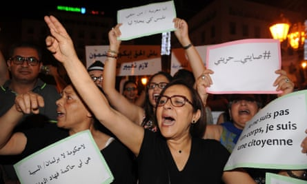 Protesters in Rabat against arrest of two women for wearing too tight skirts.