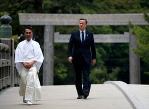 David Cameron walks over Ujibashi Bridge as he visits the Ise grand shrine ahead of the first G7 session
