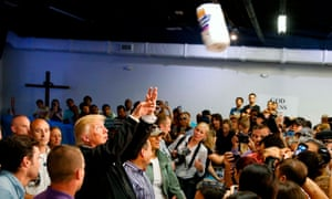 President Trump throws a roll of paper towels to residents gathered in a chapel while visiting areas damaged by Hurricane Maria in San Juan, Puerto Ricoin October 2017