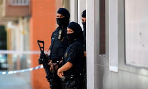 Catalan police outside the apartment of a man who tried to attack a police station in Cornellà de Llobregat