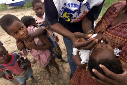 Prevention to cure ... a health worker administers oral polio vaccine to a child at the Kamina Island in the Democratic Republic of the Congo.
