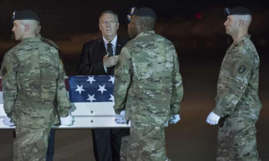 The US secretary of state, Mike Pompeo, watches as an army carry team moves a transfer case containing the remains of Sgt 1st Class Elis Barreto Ortiz, 34, from Morovis, Puerto Rico, at Dover air force base, Delaware.