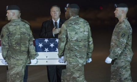 Mike Pompeo attends as an army carry team moves a transfer case containing the remains of Sgt.1st Class Elis Barreto Ortiz, 34, from Morovis, Puerto Rico, at Dover air force base, Delaware.