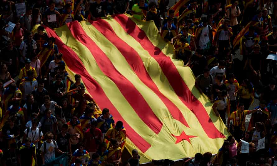 Students hold a Catalan flag during a demonstration against the Spanish government, 28 September 2017.