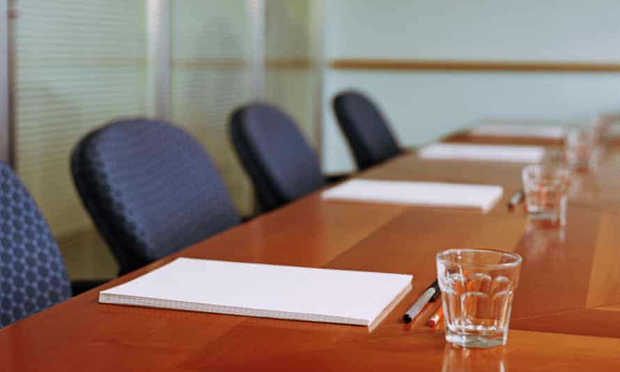 Empty chairs in boardroom