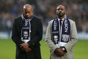 Dion Dublin and Jason Roberts line up during a minute's silence in memory of Cyrille Regis.