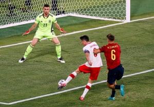 Poland's Robert Lewandowski shoots at goal.