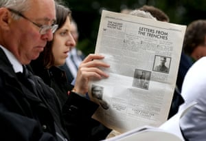 A guest reads a reprinted newspaper