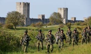 Soldiers from Sweden's Skaraborg regiment patrol during a military manoeuvre in Visby, on the island of Gotland.