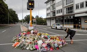 Large pile of floral tributes at a traffic light in Christchurch