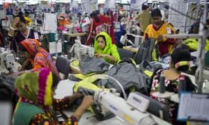 In this April 19, 2018 photo, Bangladeshis work at Snowtex garment factory in Dhamrai, near Dhaka, Bangladesh.