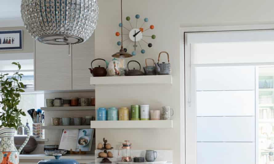 Kitchen shelving with colourful pots and a large bright window