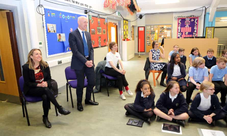 Katharine Viner, left, and Russell Scott, standing, on a visit to Russell Scott primary school
