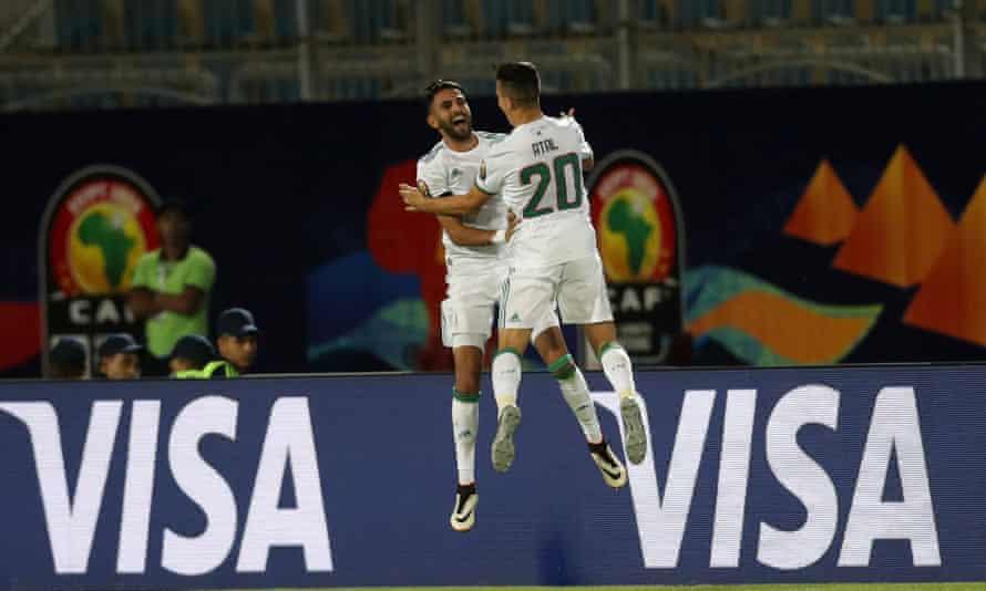 Riyad Mahrez celebrates his goal with Youcef Atal.