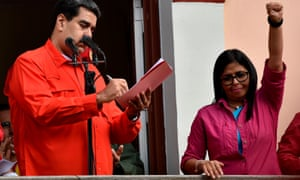Delcy Rodríguez gives a clenched-fist salute alongside Venezuela's President Nicolás Maduro in Caracas in January.