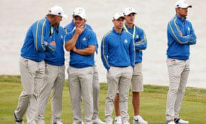 Paul Casey, Rory McIlroy and Bernd Wiesberger watch the action on the 17th hole.