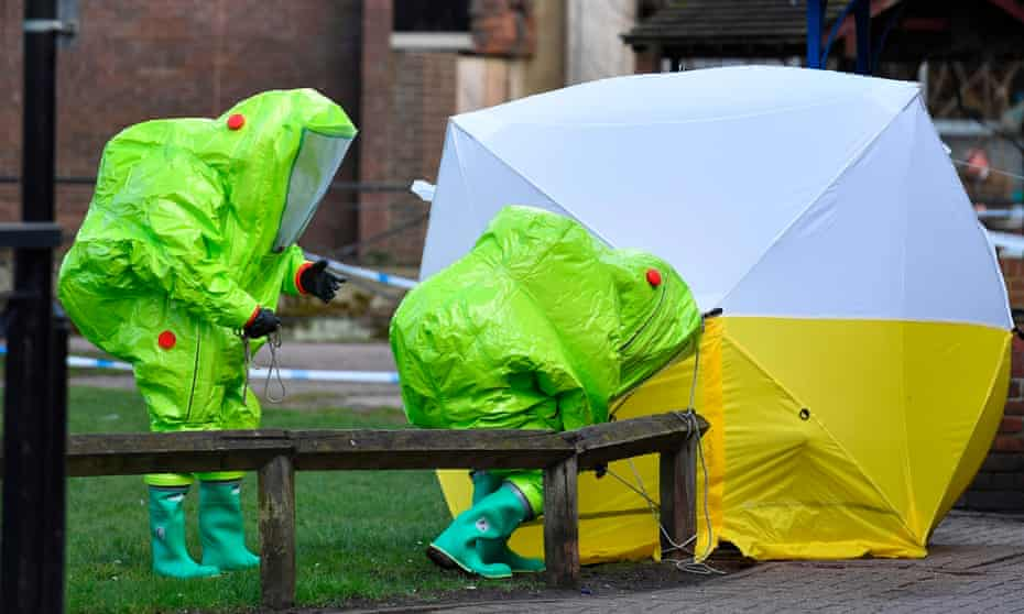 Police officers in biohazard suits at the site of the Salisbury poisoning in March 2018.