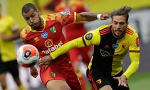 Norwich City's Onel Hernandez (left) tussles with Watford's Kiko Femenia.