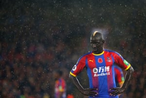 Crystal Palace's Mamadou Sakho looks on in the rain as Tottenham go 1-0 up at Selhurst Park.