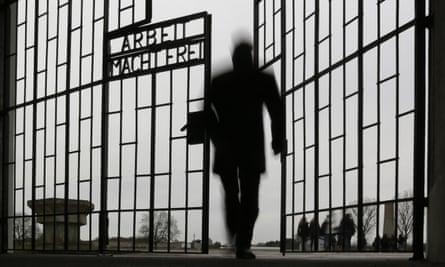 A man enters the Sachsenhausen concentration camp