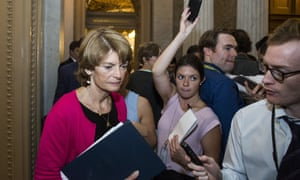 Lisa Murkowski leaves the Senate Chamber after the vote.