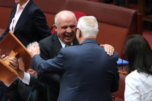 "Senator John ""Waca"" Williams is congratulated by Doug Cameron after delivering his valedictory speech in the senate chamber of Parliament House Canberra this evening."