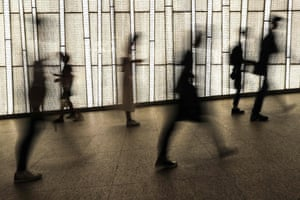 Hong Kong, ChinaPeople are seen silhouetted against a storefront display