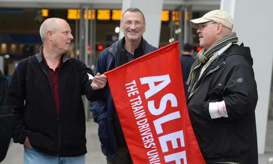 Aslef train drivers at a picket line last year.