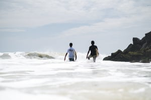 Two local lads heading into the water at Mahabalipuram, India.