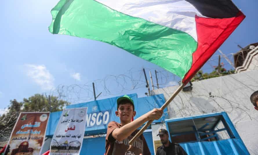 A Palestinian boy waves a flag during the protest against Israeli violations and restrictions against the al-Aqsa mosque, Gaza City.